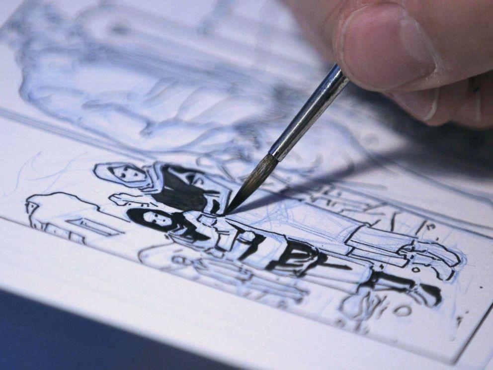 PHOTO: Dalibor Talajic drawing a panel from Madaya Mom.
