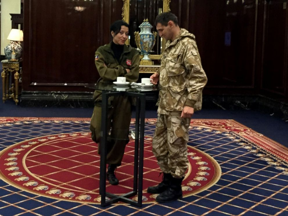 PHOTO: Two representatives of the self-proclaimed Donetsk Peoples Republic, the pro-Russian rebel government in eastern Ukraine, drink tea during a conference of separatist groups in Moscows Ritz Hotel.