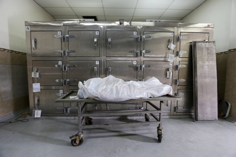 Bodies of homicide victims inside Medicina Legal, San Salvador's morgue. Last year El Salvador became the murder capital of the world, with 104 homicides per 100,000 residents. That's more than 20 times the rate in the United States.