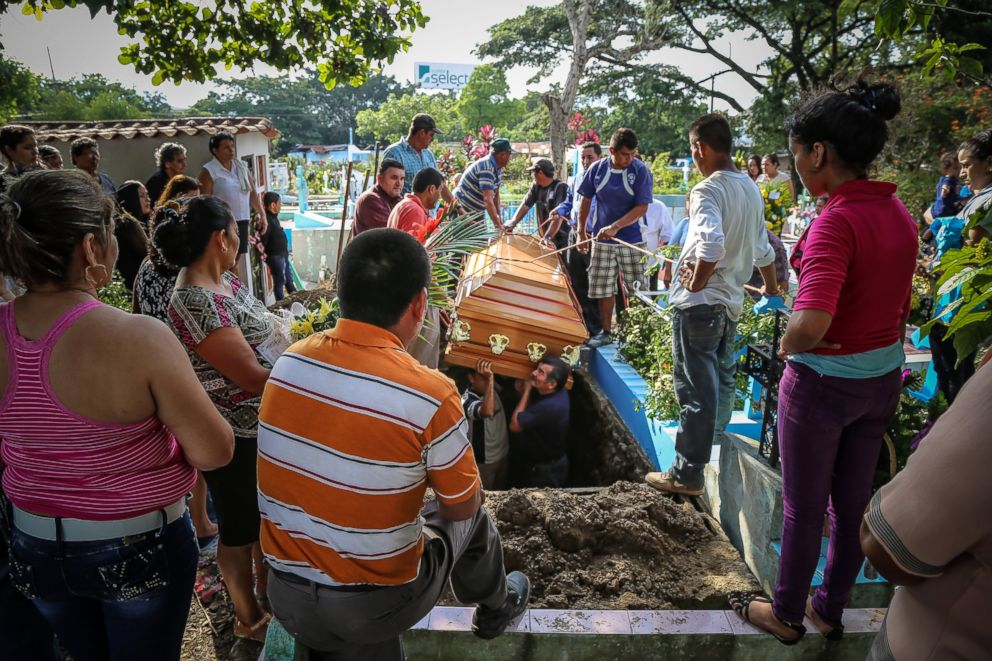 Family members and friends gather for the burial of Alexis, a 17-year-old who was killed by the MS-13 gang. Two months earlier, his older brother, Roberto, was killed by a gang, leaving their youngest brother, Jorje, the family's only surviving son.