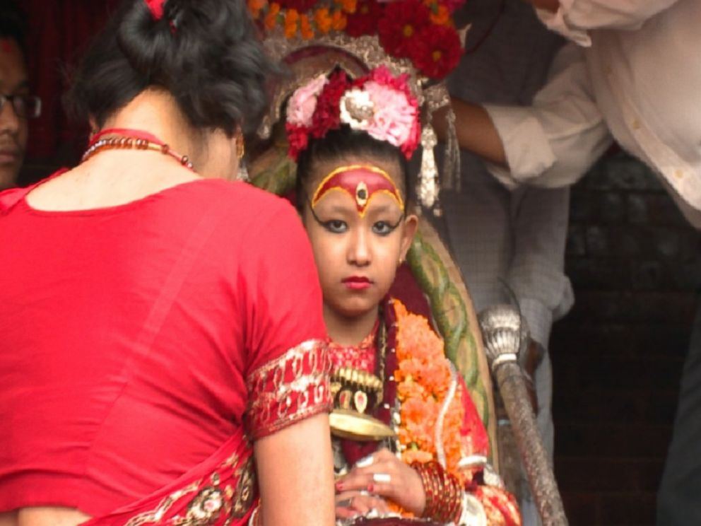 PHOTO: The young girl pictured is a Kumari - a centuries-old tradition of living, breathing child goddesses in Nepal, where its considered good luck to merely lay eyes on her.