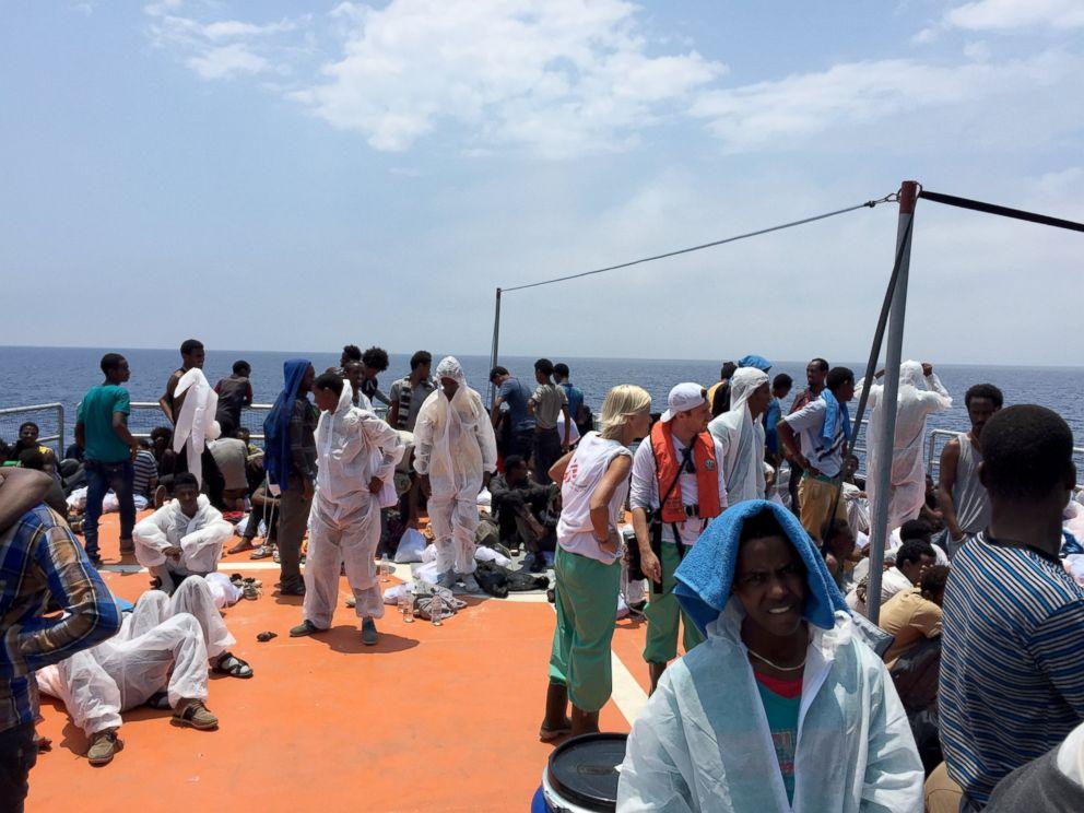 PHOTO: Migrants take refuge on MOAS's rescue vessel, the Phoenix.