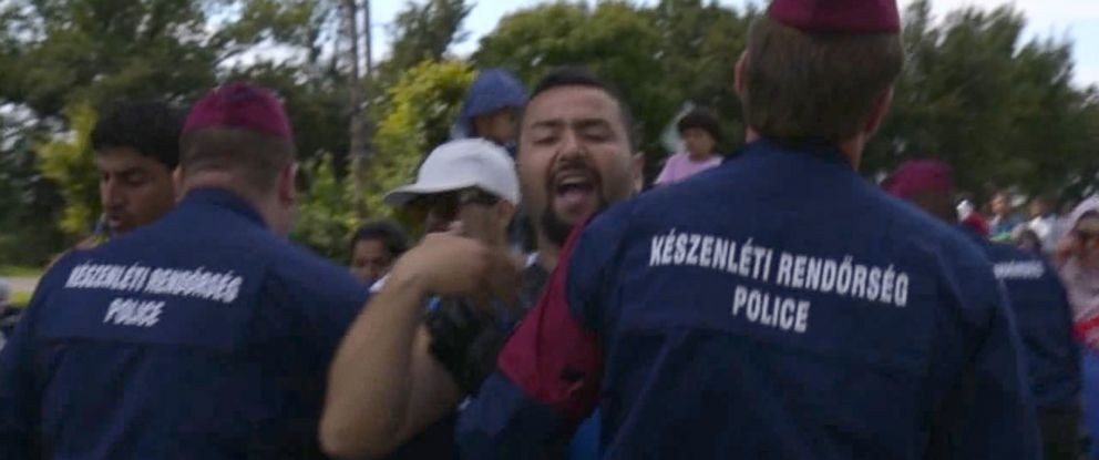 PHOTO: ABC News travels alongside refugees as they flee police in Hungary.