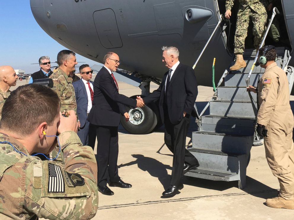 PHOTO: U.S. Sec. of Defense Jim Mattis, center, is greeted by U.S. Ambassador Douglas Silliman as he arrives at Baghdad International Airport on an unannounced trip Monday, Feb. 20, 2017.