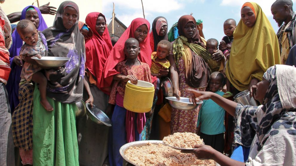 Newly arrived Somalis, displaced by the drought, receive food distributions at makeshift camps in the Tabelaha area on the outskirts of Mogadishu, Somalia, on March 30, 2017.