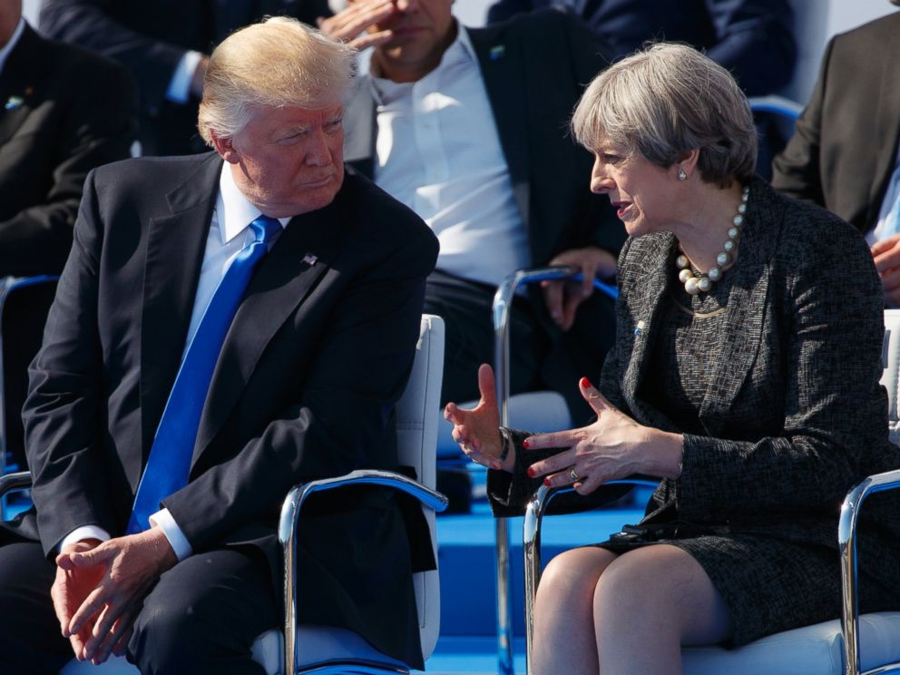 PHOTO: President Donald Trump talks with British Prime Minister Theresa May during a transfer ceremony at the new NATO headquarters, on May 25, 2017, in Brussels.