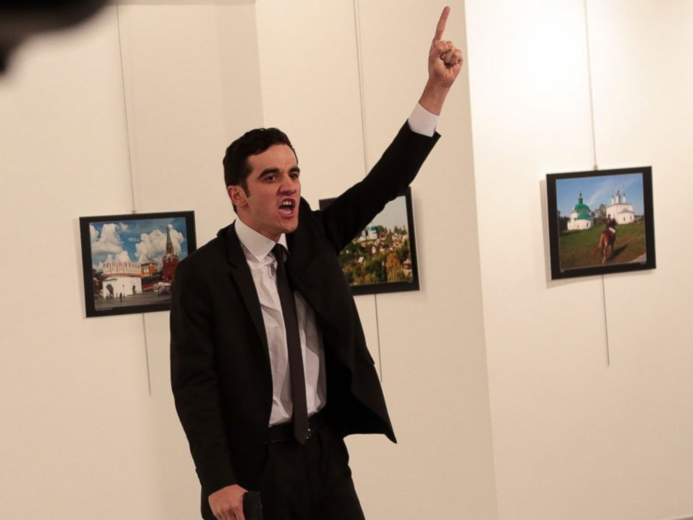 PHOTO: A man identified as Mevlut Mert Altintas gestures near to the body of a man at a photo gallery in Ankara, Turkey, Dec. 19, 2016. An Associated Press photographer says a gunman has fired shots at the Russian ambassador to Turkey.