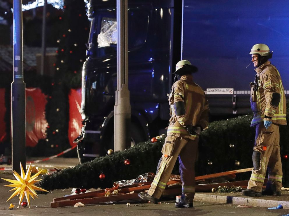 PHOTO: Firefighters look at a toppled Christmas tree after a truck ran into a crowded Christmas market and killed several people in Berlin, Dec. 19, 2016.