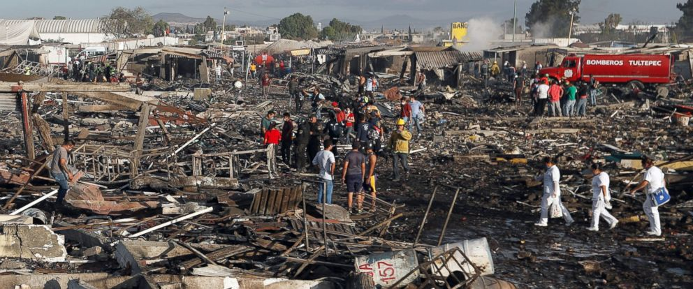 PHOTO: Firefighters and rescue workers walk through the scorched ground of Mexicos best-known fireworks market after an explosion in Tultepec, Mexico, Dec. 20, 2016.