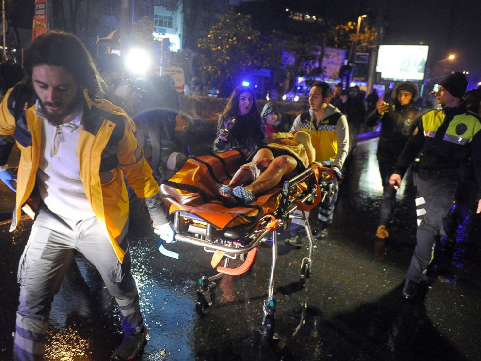 PHOTO: Medics carry a wounded person at the scene after an attack at a popular nightclub in Istanbul, early on Jan. 1, 2017.
