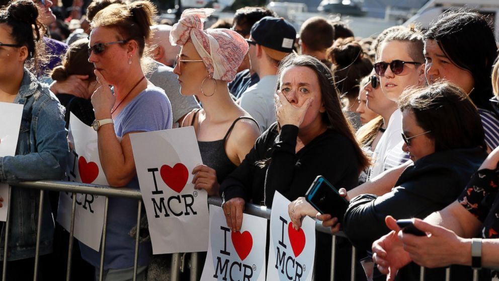 People attend a vigil in Albert Square, Manchester, England, May 23, 2017.