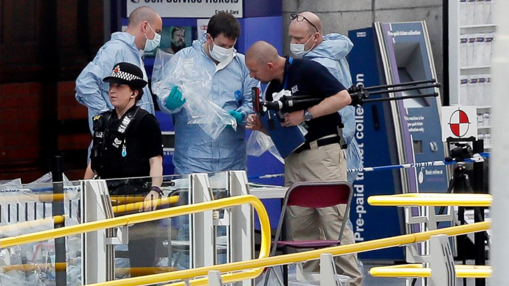 Forensic officers investigate the scene near the Manchester Arena in Manchester, England, May 23, 2017.