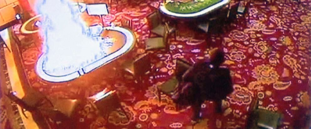 PHOTO: Manila Police and Resorts World Manila released this image made from security video on June 3, 2017 showing a gunman walking away after setting fire to a gambling table in the Resorts World Manila entertainment and gambling complex, June 2, 2017.