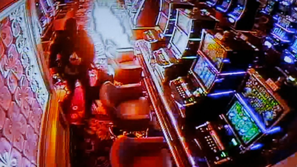 Police authorities and Resorts World Manila complex security play a CCTV video of the gunman setting fire inside a casino during a news conference, June 3, 2017, in Pasay city, southeast of Manila, Philippines.