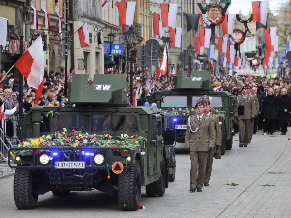 PHOTO: In this Sunday, April 18, 2010, file photo, a Polish guard of honor escorts the coffins of late Polish President Lech Kaczynski and his wife Maria Kaczynska during a funeral procession walk through Krakow, Poland.