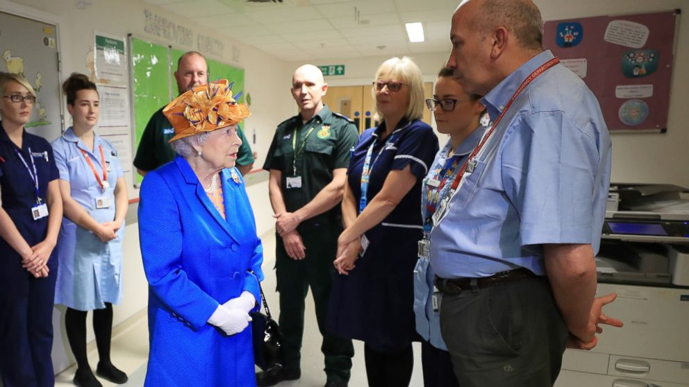 Britain's Queen Elizabeth II speaks with hospital personnel as she visits the Royal Manchester Children's Hospital to meet victims and to thank members of staff who treated them, May 25, 2017.
