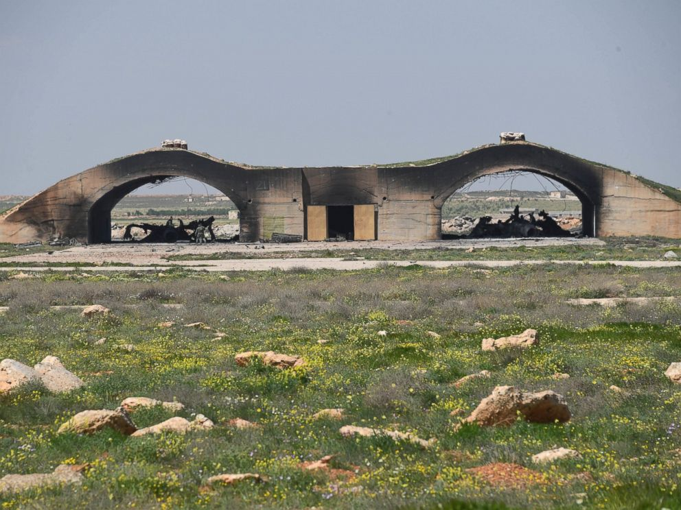PHOTO: In a photo released by the Russian state-owned news outlet, Sputnik, the remains of two planes are seen underneath a shelter following the U.S. missile attack on an air base in Syria, April 7, 2017.