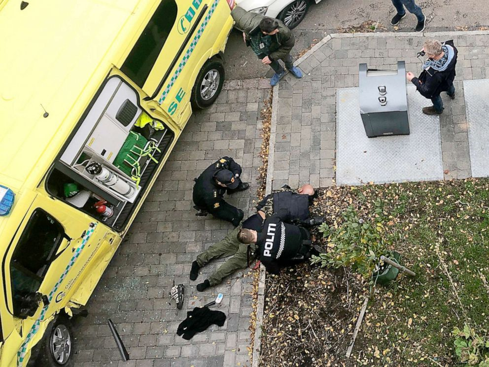 PHOTO: Police detain a man, bottom center laying on the ground, next to a damaged ambulance that he stole after an incident in the center of Oslo, Tuesday, Oct. 22, 2019. (Cathrine Hellesoy, Aftenposten via AP)