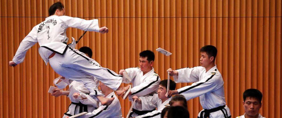 North Korean taekwondo team members display their skills at a performance in Seoul on Monday.