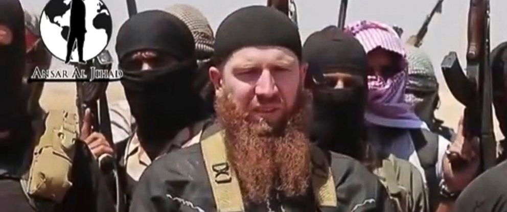 PHOTO: This image from a video posted during the weekend of June 28, 2014 by the Islamic State and the Levant (ISIL), shows Omar al-Shishani standing among a group of fighters as they declare the elimination of the border between Iraq and Syria.