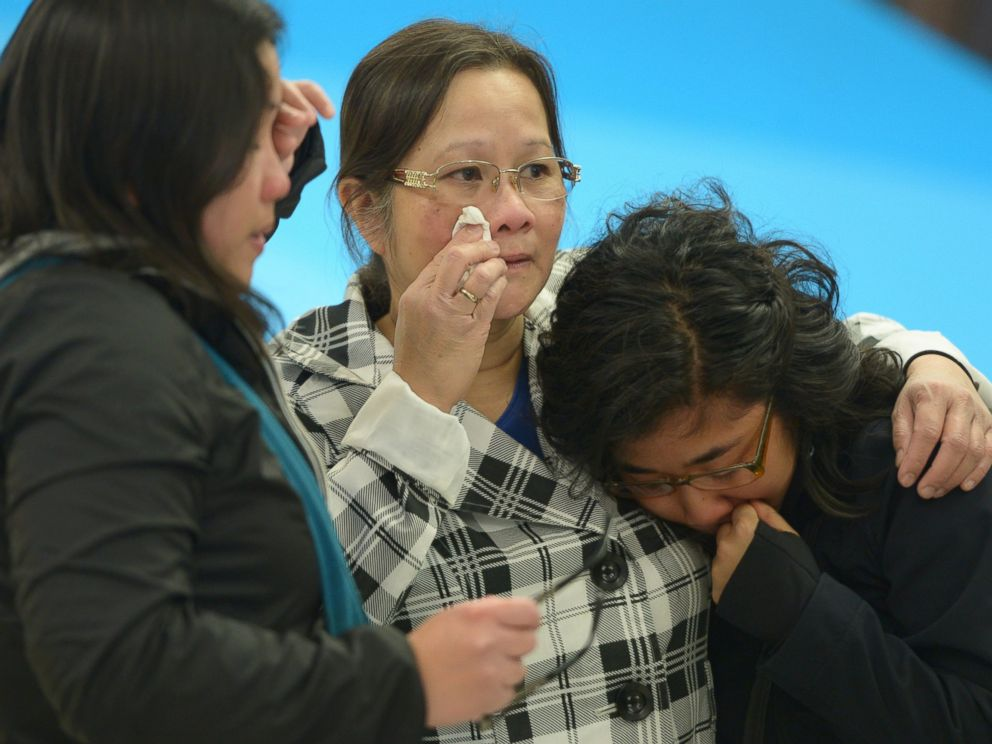 PHOTO: A woman, center, is greeted by her daughters after arriving in Edmonton from the Fort McMurray area, in Alberta, May 5, 2016.