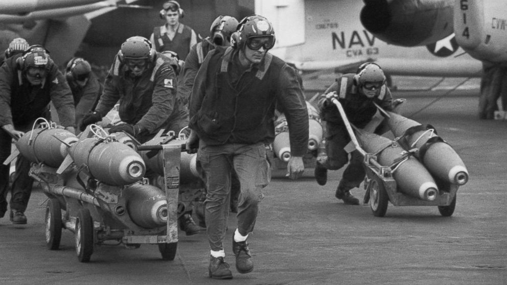 U.S. Navy armorers wheel out 500-pound bombs for the wing racks of jets being used in support for South Vietnamese troops fighting the enemy in Laos, on March 18, 1971.