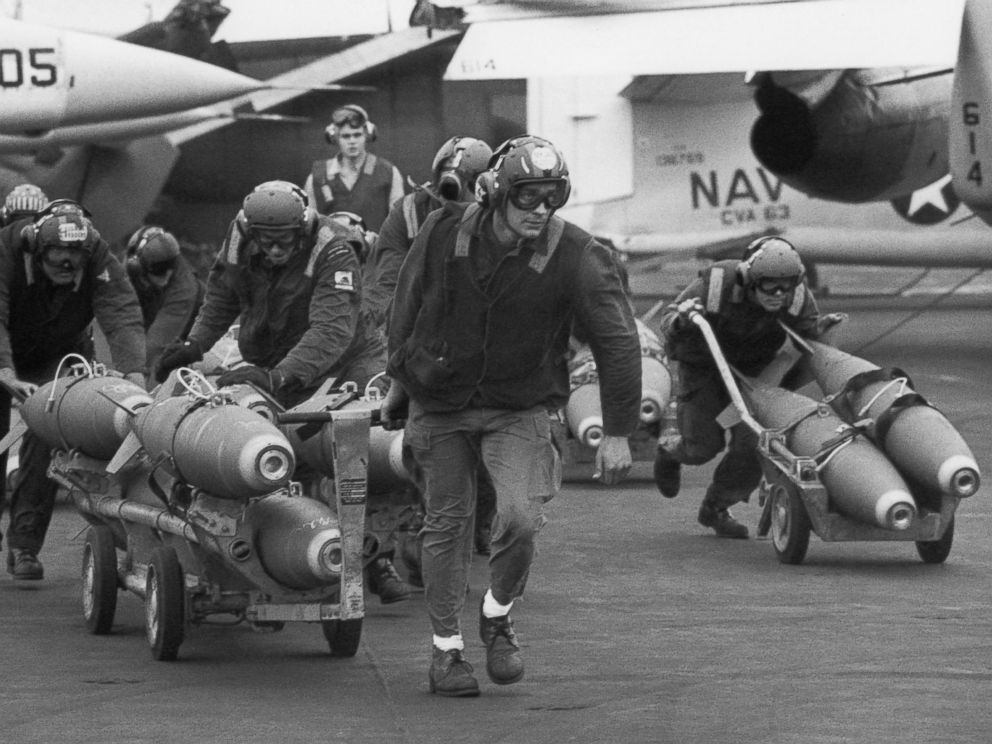 PHOTO: U.S. Navy armorers wheel out 500-pound bombs for the wing racks of jets being used in support for South Vietnamese troops fighting the enemy in Laos, on March 18, 1971.