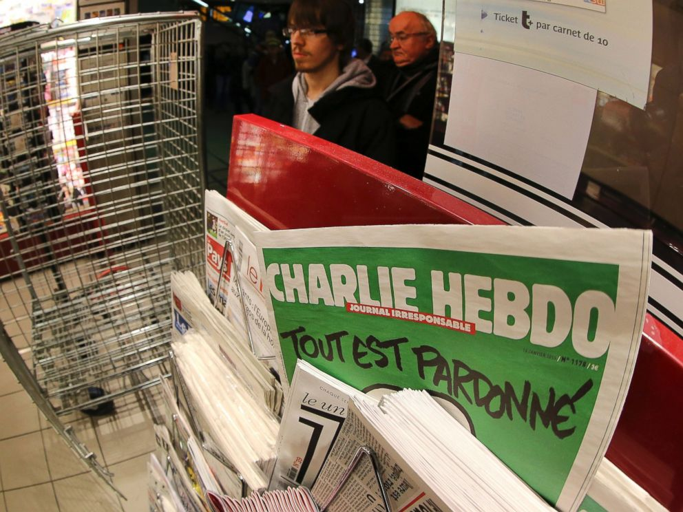 PHOTO: In this photo made with a fish-eye lens, people wait to buy the latest issue of Charlie Hebdo newspaper at a newsstand in Rennes, western France, Jan. 14, 2015.