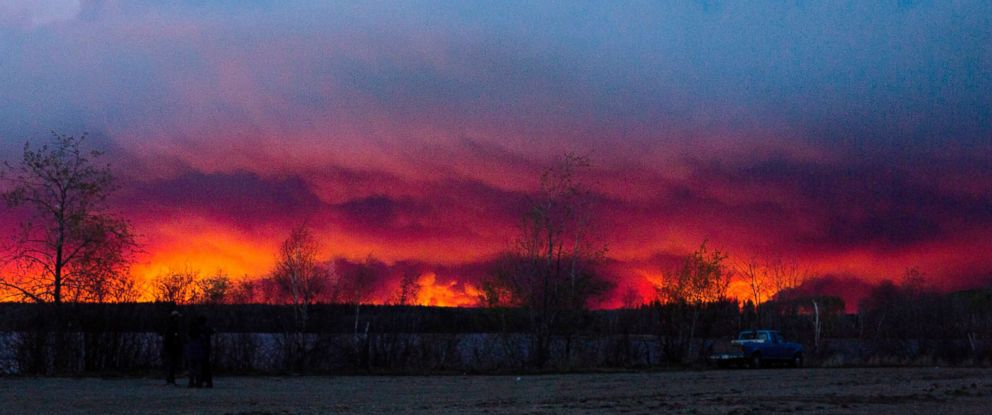 PHOTO: A wildfire moves towards the town of Anzac from Fort McMurray, Alberta., On May 4, 2016. Alberta declared a state of emergency Wednesday as crews frantically held back wind-whipped wildfires.