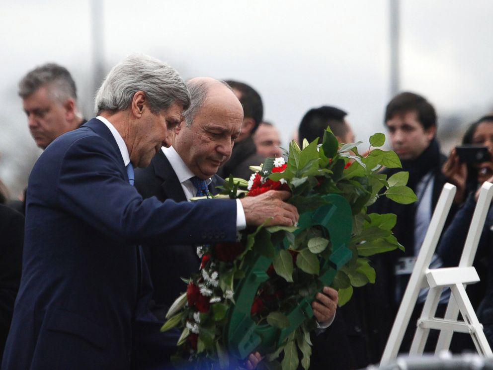 PHOTO: U.S. Secretary of State John Kerry, left, and French Foreign Minister Laurent Fabius lay flowers, Jan. 16, 2015, at the site of a kosher market where four hostages were killed in a terrorist attack last week in Paris, France.