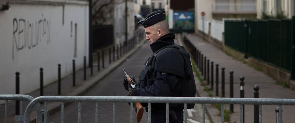 PHOTO: A French police officer stands at a road block near the offices of French satirical newspaper Charlie Hebdo in Paris, Jan. 10, 2015.