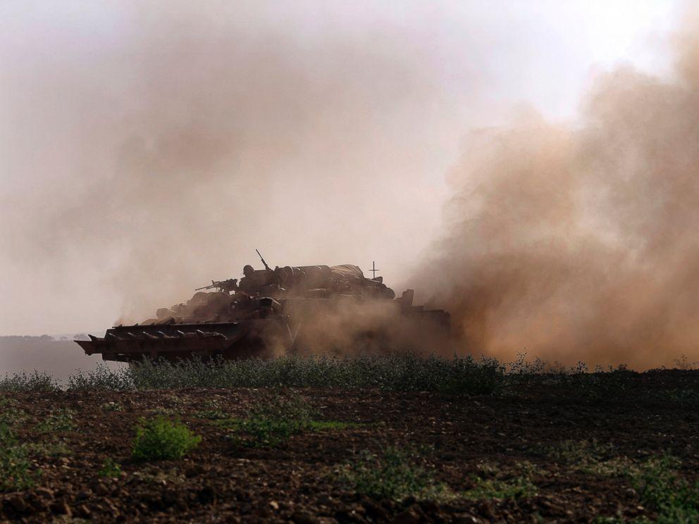 PHOTO: An Israeli tank rides along the border of Israel and the Gaza Strip, July 20, 2014.