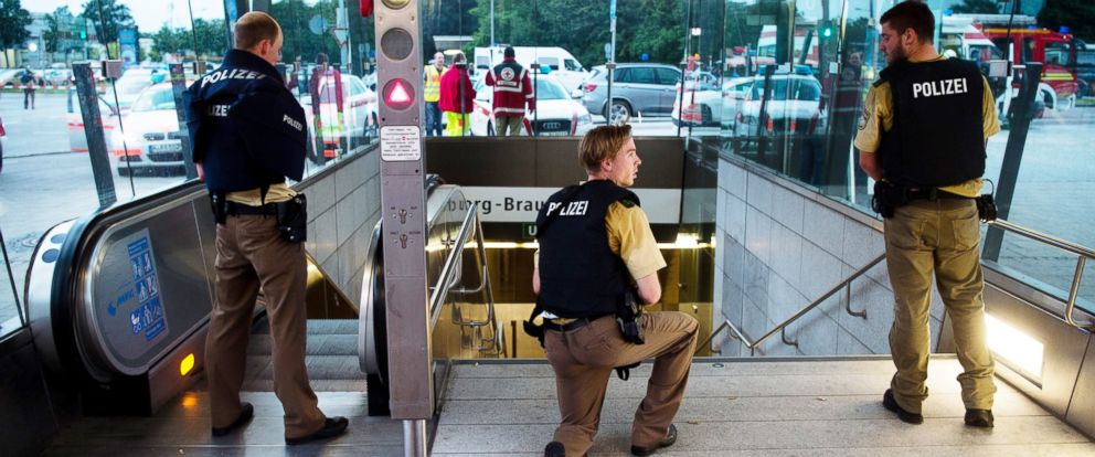PHOTO: Policemen stand at the underground station Georg-Brauchle-Ring close to the Olympia shopping centre in which a shooting was reported in Munich, on Friday, July 22, 2016. According to media reports police expect several people being killed.