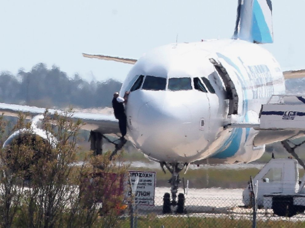PHOTO: A person is seen here jumping out of the cockpit of EgyptAir Flight 181 at Larnaca airport in Cyprus, March 29, 2016.