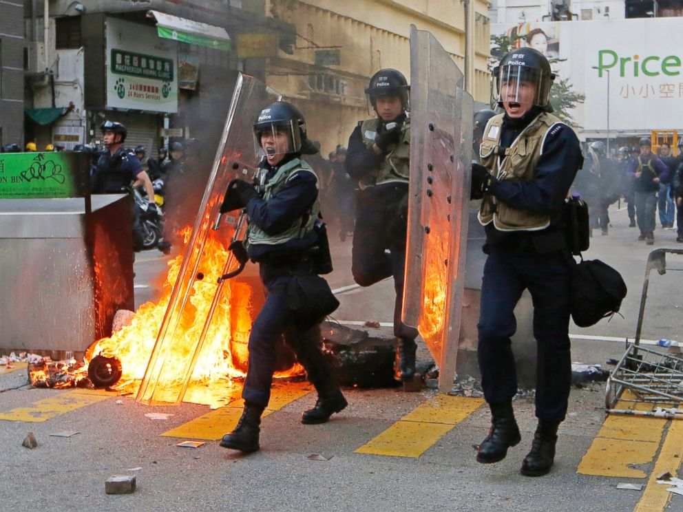 PHOTO: Riot police move forward to the protesters on a street in Mong Kok district of Hong Kong, Feb. 9, 2016.