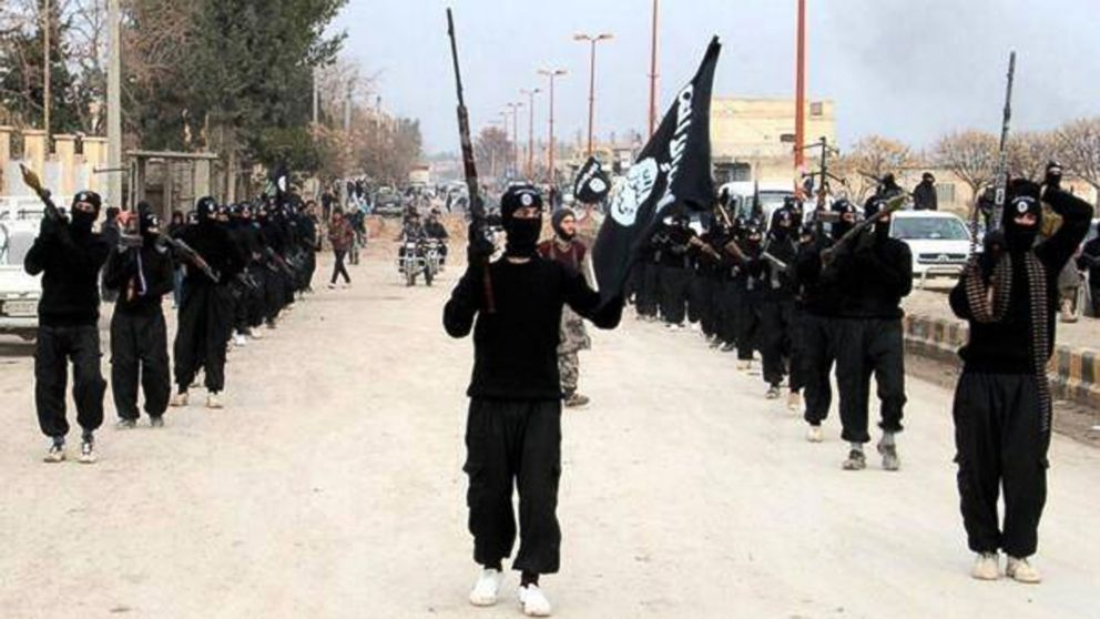 <p>	This undated file image posted on a militant website on Jan. 14, 2014, shows fighters from the al Qaida-linked Islamic State of Iraq and the Levant (ISIL) marching in Raqqa, Syria.</p>