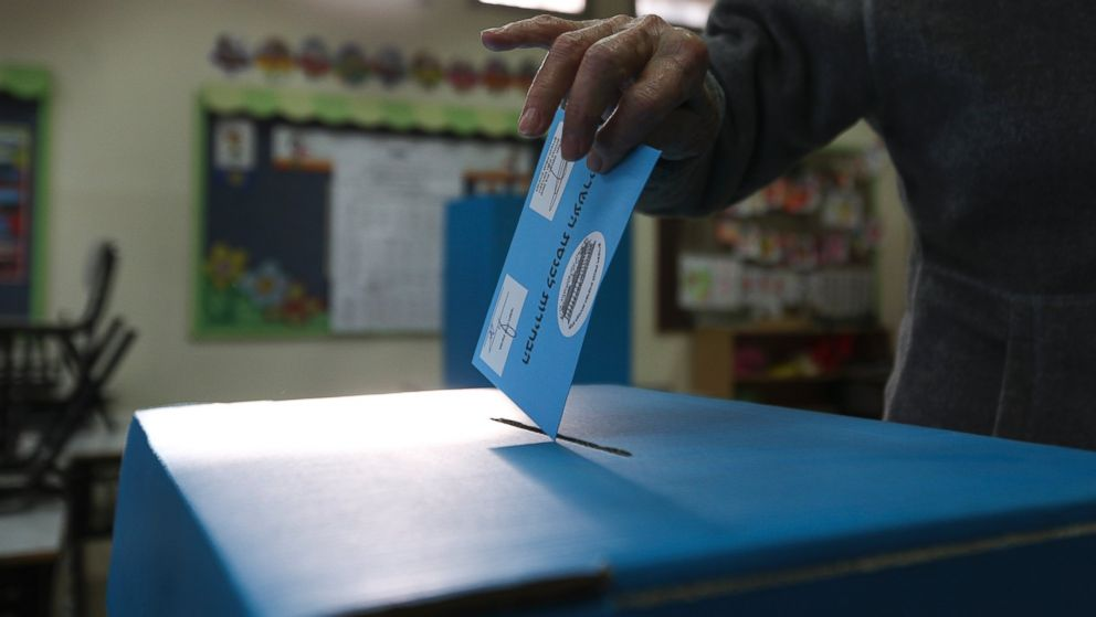 A man cast his vote during legislative elections in Tel Aviv, Israel, Tuesday, March 17, 2015. Israelis are voting in early parliament elections following a campaign focused on economic issues such as the high cost of living, rather than fears of a nuclear Iran or the Israeli-Arab conflict.