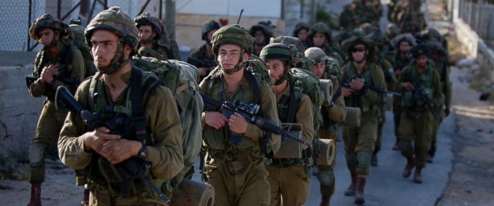 PHOTO: Israeli soldiers search for three missing teenagers during a military operation in the West Bank city of Hebron, June 17, 2014.