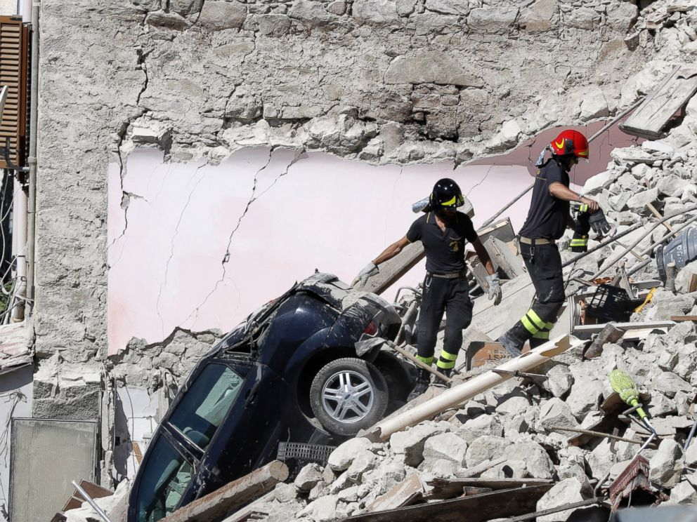 PHOTO: Rescuers make their way through destroyed houses following Wednesdays earthquake in Pescara Del Tronto, Italy, Thursday, Aug. 25, 2016.