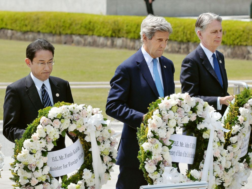 PHOTO: From left, Japans Foreign Minister Fumio Kishida, U.S. Secretary of State John Kerry and Britains Foreign Minister Philip Hammond carry wreaths to offer at the cenotaph at Hiroshima Peace Memorial Park in Hiroshima, western Japan, April 11, 2016.