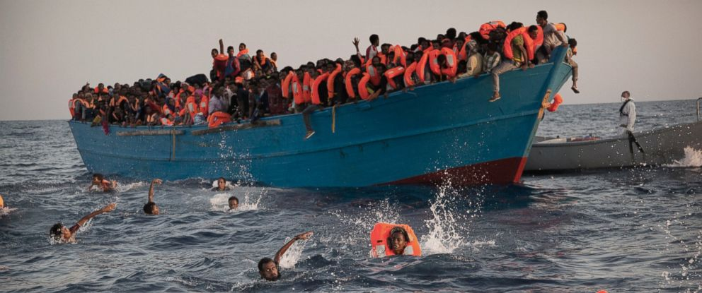 PHOTO: Migrants, most of them from Eritrea, jump into the water from a crowded wooden boat as they are helped by members of an NGO during a rescue operation at the Mediterranean sea, about 13 miles north of Sabratha, Libya, Aug. 29, 2016.
