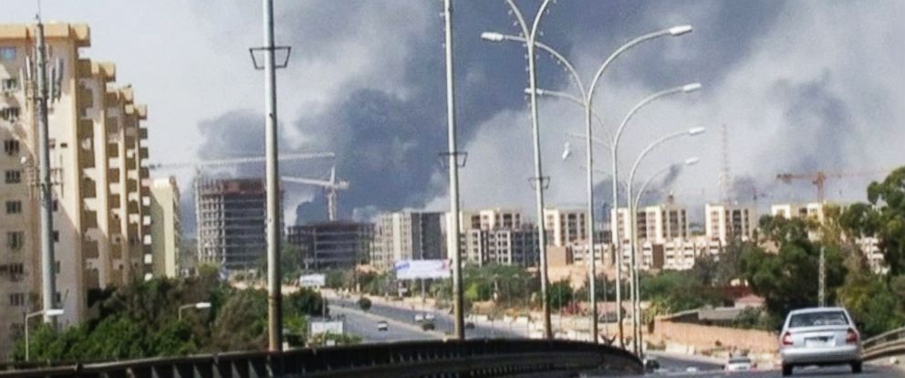 PHOTO: In this image made from video by The Associated Press, smoke rises from the direction of Tripoli airport in Tripoli, Libya, Sunday, July 13, 2014.