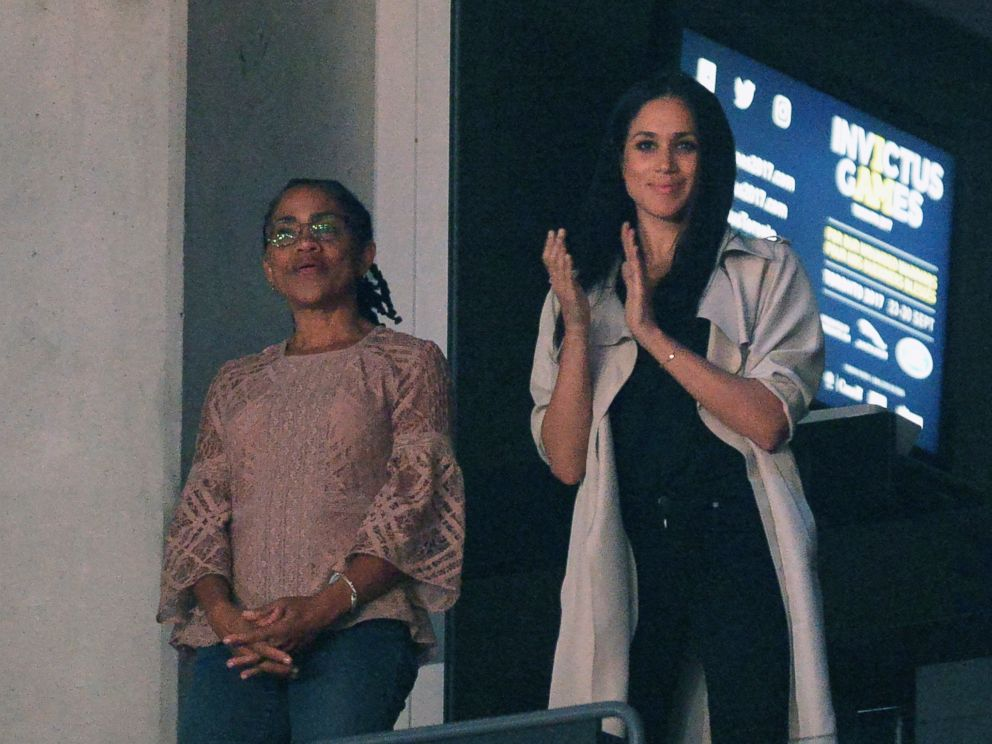 Meghan Markle, right, watches the closing ceremonies of the Invictus Games with her mother Doria Radlan in Toronto, Sept. 30, 2017.