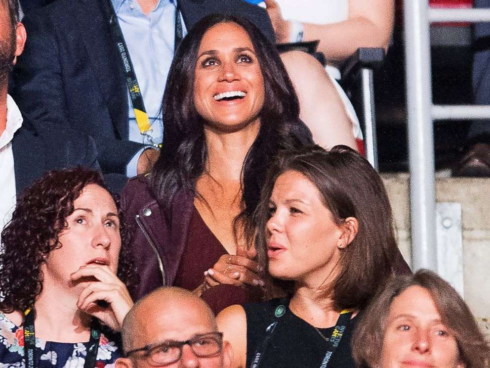 Meghan Markle, top, attends the Invictus Games Opening Ceremonies in Toronto on Saturday, Sept. 23, 2017, a few rows apart from her boyfriend, Britains Prince Harry. Markle lives in Toronto, but hadnt appeared with Harry since he arrived in the city.