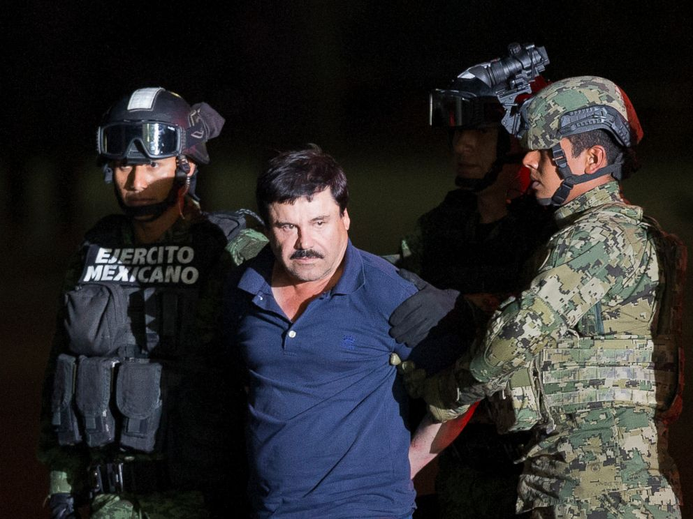 PHOTO: Joaquin El Chapo Guzman is made to face the press as he is escorted to a helicopter in handcuffs by Mexican soldiers and marines at a federal hangar in Mexico City, Mexico, Friday, Jan. 8, 2016.