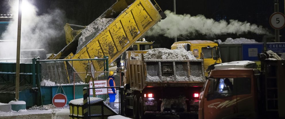 PHOTO: A municipal worker watches as a truck empties snow removed from Moscows roads at a snow-melting station in Moscow, Russia, Jan. 15, 2016.
