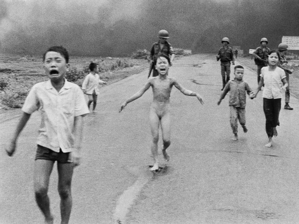 PHOTO: In June 8, 1972, 9-year-old Kim Phuc, center, runs with her brothers and cousins, followed by South Vietnamese forces, near Trang Bang after a South Vietnamese plane accidentally dropped its flaming napalm on its own troops and civilians.