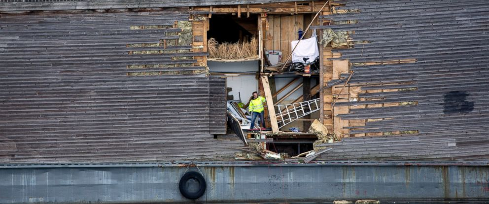 PHOTO: A crew member inspects the damage of the hull of a wooden exhibition ship built as a representation of Noahs Ark after it crashed into a moored Coast Guard vessel in Oslo harbor, June 10, 2016, in Oslo.