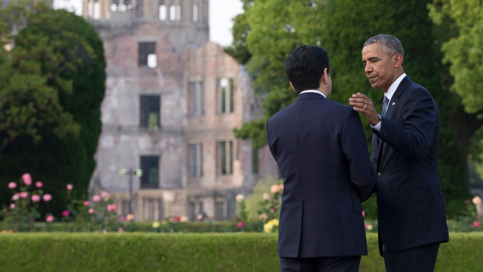 President Barack Obama and Japanese Prime Minister Shinzo Abe speak with the Atomic Bomb Dome seen at rear at the Hiroshima Peace Memorial Park in Hiroshima, western Japan, May 27, 2016.