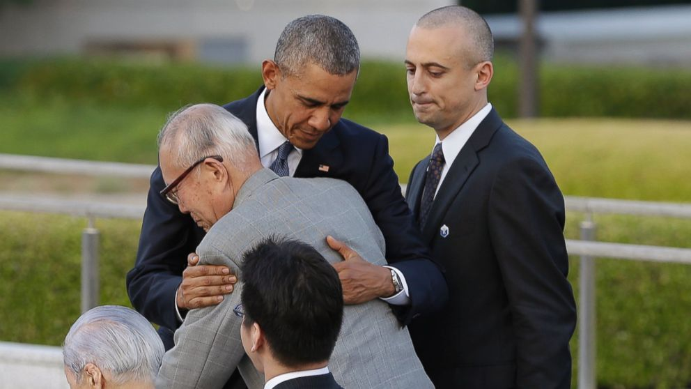President Barack Obama hugs Shigeaki Mori, an atomic bomb survivor and a creator of the memorial for American WWII POWs killed in Hiroshima, during a ceremony at Hiroshima Peace Memorial Park in Hiroshima, western, Japan, May 27, 2016.